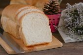 Sliced Soft And Sticky Delicious White Bread On Wood Cutting Board. Prepare Bread For Breakfast On W poster