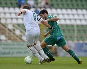 KAPOSVAR, HUNGARY - AUGUST 27: Pedro Sass (in green) in action at a Hungarian National Championship soccer game - Kaposvar (green) vs Paks (white) on August 27, 2011 in Kaposvar, Hungary.