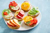 Fruit Dessert Sandwiches With Ricotta Cheese. Delicious Healthy Breakfast Toasts With Cream Cheese,  poster