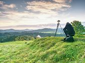 Long Hair Woman Photographer Stand On Meadow And Wait For Sunrise. Short  Grass And  Misty And Light poster