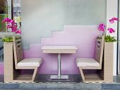 Table and chair in restaurant with flowers