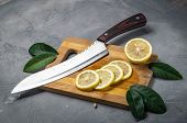 Raw Food: Fresh Juicy Lemon. Slice Thin Slices On A Cutting Board. poster