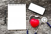 Health Red Heart With Stethoscope And Blank Notebook For Input Some Text With Pen And Blank Screen O poster