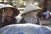 Vietnamese Women wearing Conical Hats