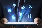 Business Concept On Tablet With Hologram In The Office poster
