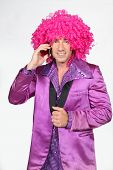 picture of fancy-dress  - Man in Seventies costume and crazy wig on cellphone - JPG