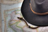 Felt Hat Over Vintage, Warn Out Map Of South America (1926 Edition)
