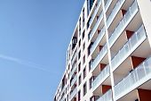 Modern Apartment Buildings On A Sunny Day With A Blue Sky. Facade Of A Modern Apartment Building poster