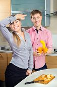 image of dildo  - Happy Couple having fun on a kitchen - JPG