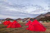 Camping Tents In The Mountains, Tents And Clothing Line With Volcanic Mountain Background, Landmanna poster