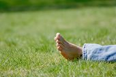 Feet By Leisure Lying In A Grass