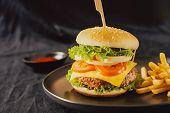 Unhealthy Concept. Unhealthy Food: Burger, Sauce, Potatoes, Cola. poster