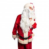 Middle age handsome man wearing Santa Claus costume and beard standing hand on mouth telling secret  poster