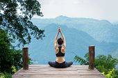 Healthy Woman Lifestyle Balanced Practicing Meditate And Zen Energy Yoga Outdoors On The Bridge In M poster