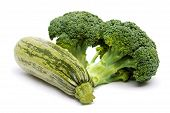 Zucchini and broccoli on white background