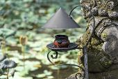 Vintage Kerosene Lamp As Gardening Decoration. Tropical Asian Natural Style In Island Bali, Indonesi poster