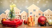 Wooden Houses, Christmas Tree And Gifts. Christmas Sale Of Real Estate. New Year Discounts For Buyin poster