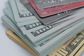 Many Us Dollar Bank Notes With Many Credit Cards As For Business Background. poster