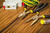 Tools And Spare Parts For Electrician On Vintage Wooden Boards poster