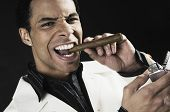 Mixed Race man lighting cigar