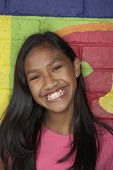 stock photo of pacific islander ethnicity  - Pacific Islander girl in front of mural - JPG