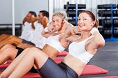 fitness people doing sit ups in gym