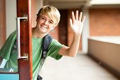cute high school boy waving good bye