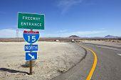 Mojave desert freeway and interstate 15 sign near Baker California.