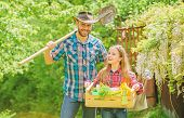 Family Dad And Daughter Little Girl Planting Plants. Day At Farm. Planting Flowers. Plant Veggies. P poster