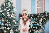 Merry Christmas, Happy Holidays! New Year. Little Girl Sits Near Christmas Tree On Porch Of House. C poster