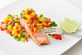 Salmon Fillet With Mango Salsa On White Plate.