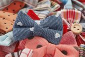 stock photo of bow tie hair  - Bow ties and hair bows pile - JPG