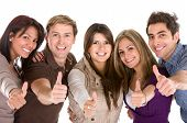 stock photo of thumbs-up  - Cheerful group of friends with thumbs up isolated - JPG