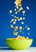 Corn Flakes Falling To The Bowl For Breakfast