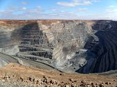 stock photo of dumper  - Kalgoorlie Super Pit is a large gold mine in the Western Australian outback - JPG