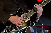 image of guitar  - Musician plays the electric guitar at a blues festival - JPG