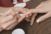 stock photo of french manicure  - Professional manicure in a nail studio with different instruments - JPG