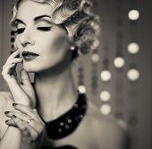 Monochrome portrait of elegant blond retro woman with beautiful hairdo