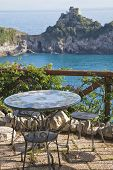 Table and chairs overlooking the Mediterranean on the amalfi coast.