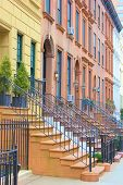 stock photo of brownstone  - Brownstone homes taken in a New York City - JPG