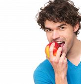 Portrait of a Handsome Young Man Eating Apple