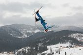 BUKOVEL, UKRAINE - FEBRUARY 23: Mykola Puzderko, Ukraine performs aerial skiing during Freestyle Ski World Cup in Bukovel, Ukraine on February 23, 2013