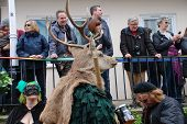 HASTINGS, ENGLAND - MAY 7: A man wearing a deer head takes parts in a parade through the Old Town during the annual Jack In The Green festival on May 7, 2012 in Hastings, East Sussex.