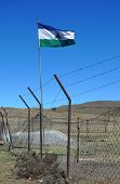 Kingdom of Lesotho flag flying at the border between South Africa and Lesotho at Sany Pass