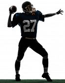 one caucasian quarterback american throwing football player man in silhouette studio isolated on whi