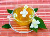 Transparent cup with jasmin tea