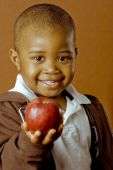 Fun Child Holds Apple