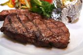 foto of porterhouse steak  - photograph of sirloin steak close up on plate - JPG