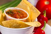 Red Roasted Tomato Salsa With Corn Chips.