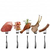 Meat Assortment With Forks Isolated On White